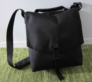 CourierWare Walking Bag stuffed with netbook, cords, camera, binos, 2 pairs of glasses and a shirt